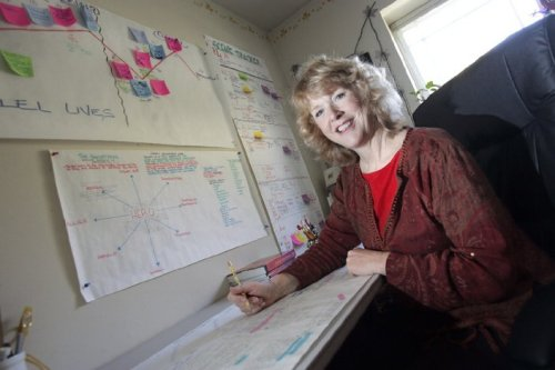 The plot whisperer, Martha Alderson, at work at her white board.